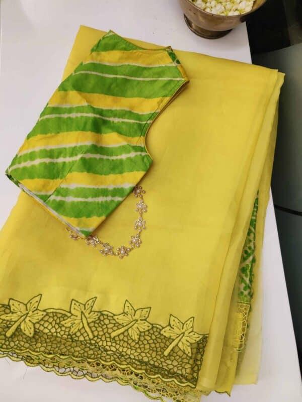 yellow cutwork saree